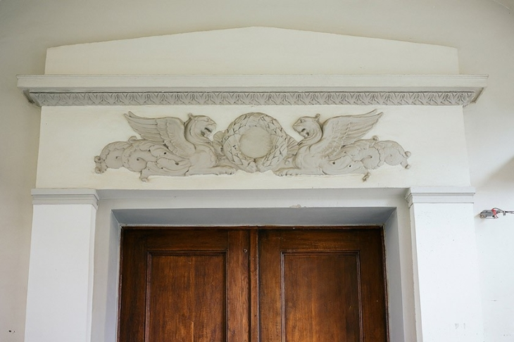 Neoclassical bas-relief over the entry into the house